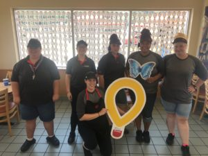 Darci (holding the balloon) and her awesome DQ Team